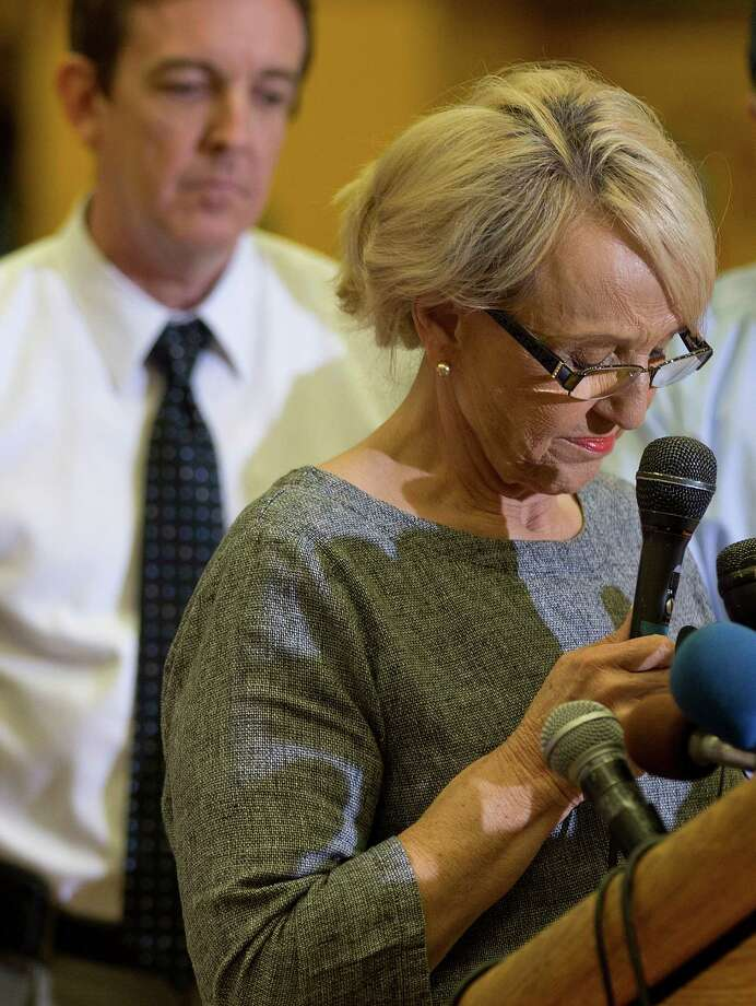 Arizona Gov. Jan Brewer pauses while speaking during a news conference, Monday, July 1, 2013, in Prescott, Ariz. Brewer signed an order declaring a state of emergency in Yavapai County due to a wildfire that overtook a firefighting crew and killed 19 people. (AP Photo/Julie Jacobson) Photo: Julie Jacobson, Associated Press / AP
