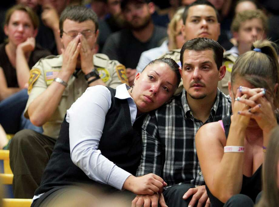 Gina Martinez, center, and Chase Madrid, center right, comfort each other during a memorial service for 19 firefighters of the Granite Mountain Hotshot Crew that were killed battling a wildfire,  Monday, July 1, 2013 in Prescott, Ariz.  Madrid is a former Granite Mountain Hotshot and knew many of the firefighters who were killed. (AP Photo/The Arizona Republic, David Wallace) Photo: David Wallace, Associated Press / The Arizona Republic