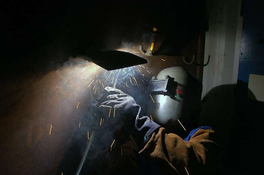 Josh Shomate, an apprentice with the Boilermakers union, works on a weld as part of his training to work at a coal-fired power plant Monday, July 1, 2013,  in Colstrip, Mont. Shomate says he quit a job with the U.S. Forest Service to pursue a career in the coal industry. (AP Photo/Mathew Brown) Photo: Matt Brown, Associated Press
