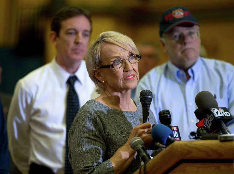 Arizona Gov. Jan Brewer answers questions during a news conference, Monday, July 1, 2013 in Prescott, Ariz. Brewer signed an order declaring a state of emergency in Yavapai County due to a wildfire that overtook a firefighting crew and killed 19  of the 20-member team. (AP Photo/Julie Jacobson) Photo: Julie Jacobson, Associated Press / AP
