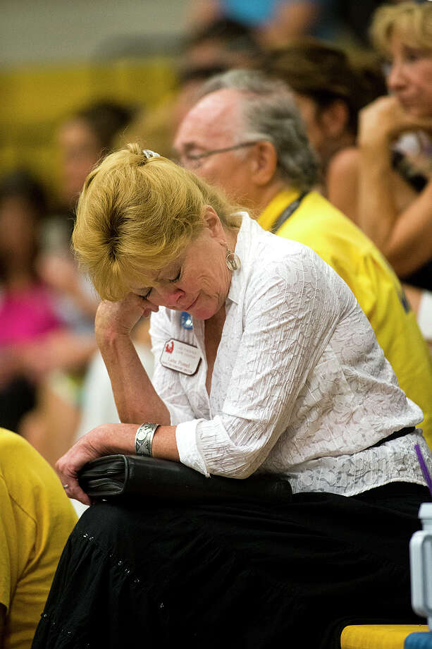 Lana Pomel,  whose friend's son was a member of the Granite Mountain Hot Shot crew,  cries listening to a news conference at Prescott High School, Monday, July 1, 2013, talking about the tragedy that took the lives of 19 members of the Granite Mountain Hot Shot crew, Sunday. (AP Photo/The Arizona Republic, Tom Tingle) Photo: Tom Tingle, Associated Press / The Arizona Republic
