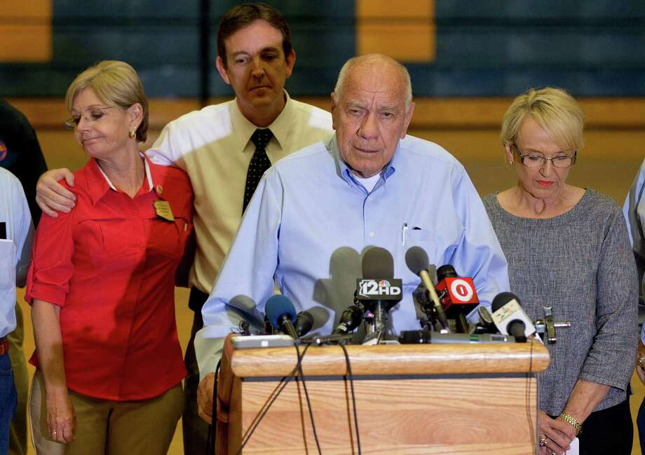 Joined by Arizona Gov. Jan Brewer, Prescott, Ariz., Mayor Marlin Kuykendall answers questions during a news conference, Monday, July 1, 2013 in Prescott, Ariz. An out-of-control blaze overtook an elite group of firefighters trained to battle the fiercest wildfires, killing 19 members as they tried to protect themselves from the flames under fire-resistant shields. The disaster Sunday afternoon all but wiped out the 20-member Hotshot fire crew leaving the city's fire department reeling.(AP Photo/Julie Jacobson) Photo: Julie Jacobson, Associated Press / AP