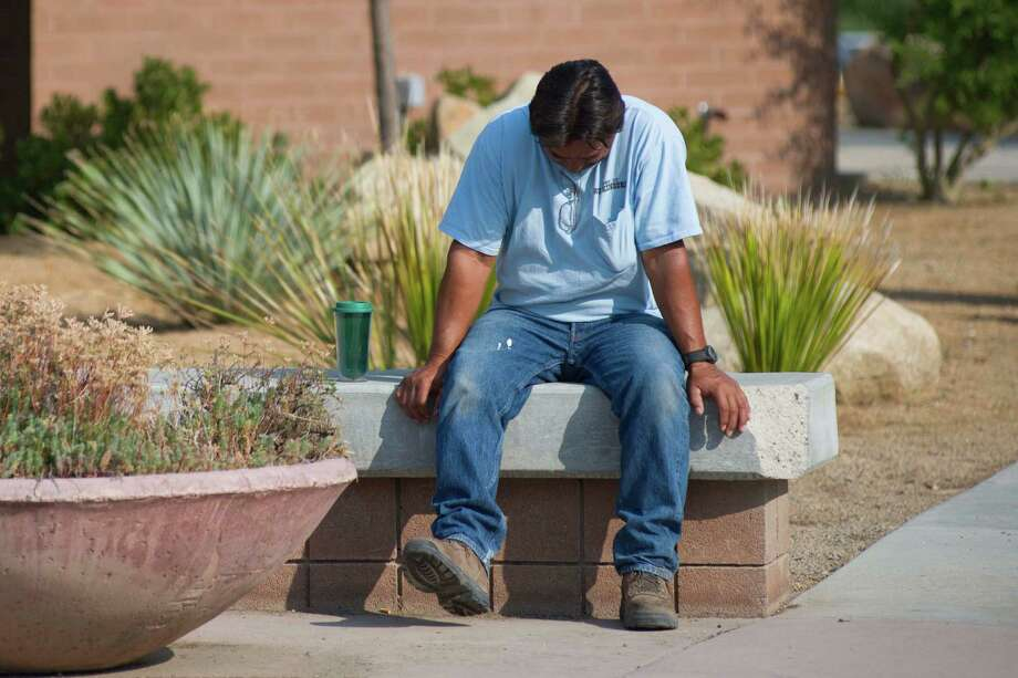 Thomas Herrera   waits for news about whether or not his home survived the Yarnell Hill Fire on Monday, July 1, 2013, at the Red Cross shelter at Yavapai College in Prescott, Ariz. The wildfire destroyed 200 houses in the town of Yarnell and the nearby community of Glen Isla. Nineteen firefighters from an elite crew from Prescott were killed in the blaze.(AP Photo/The Arizona Republic, Aaron Lavinsky)  MARICOPA COUNTY OUT; MAGS OUT; NO SALES Photo: Aaron Lavinsky, Associated Press / The Arizona Republic