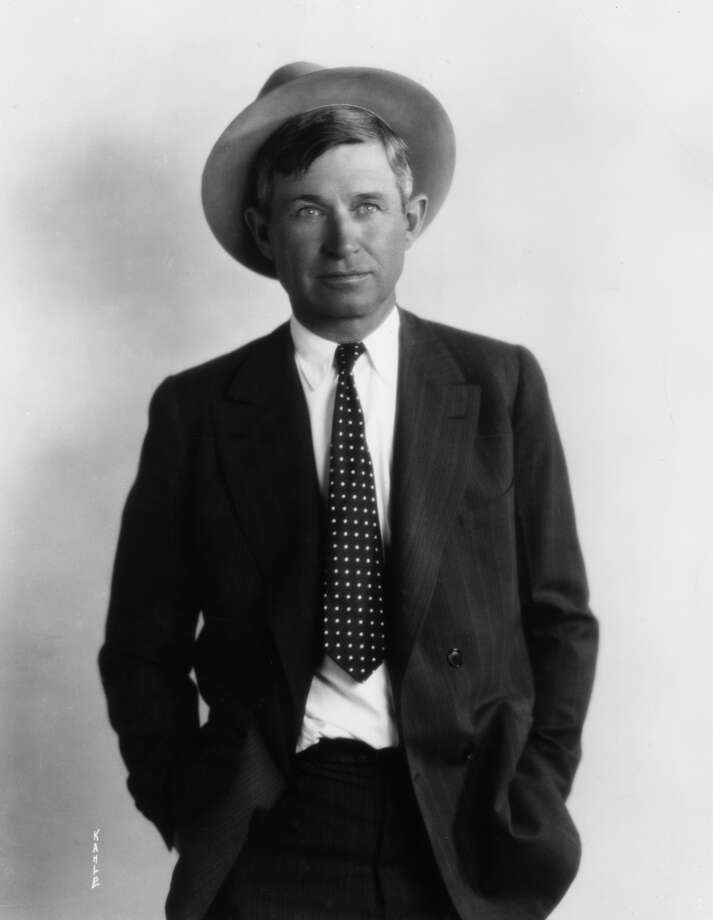 Studio portrait of American actor, humorist, and lecturer Will Rogers wearing a hat and a polka dot tie with a pinstriped suit.  (Photo by American Stock/Getty Images)