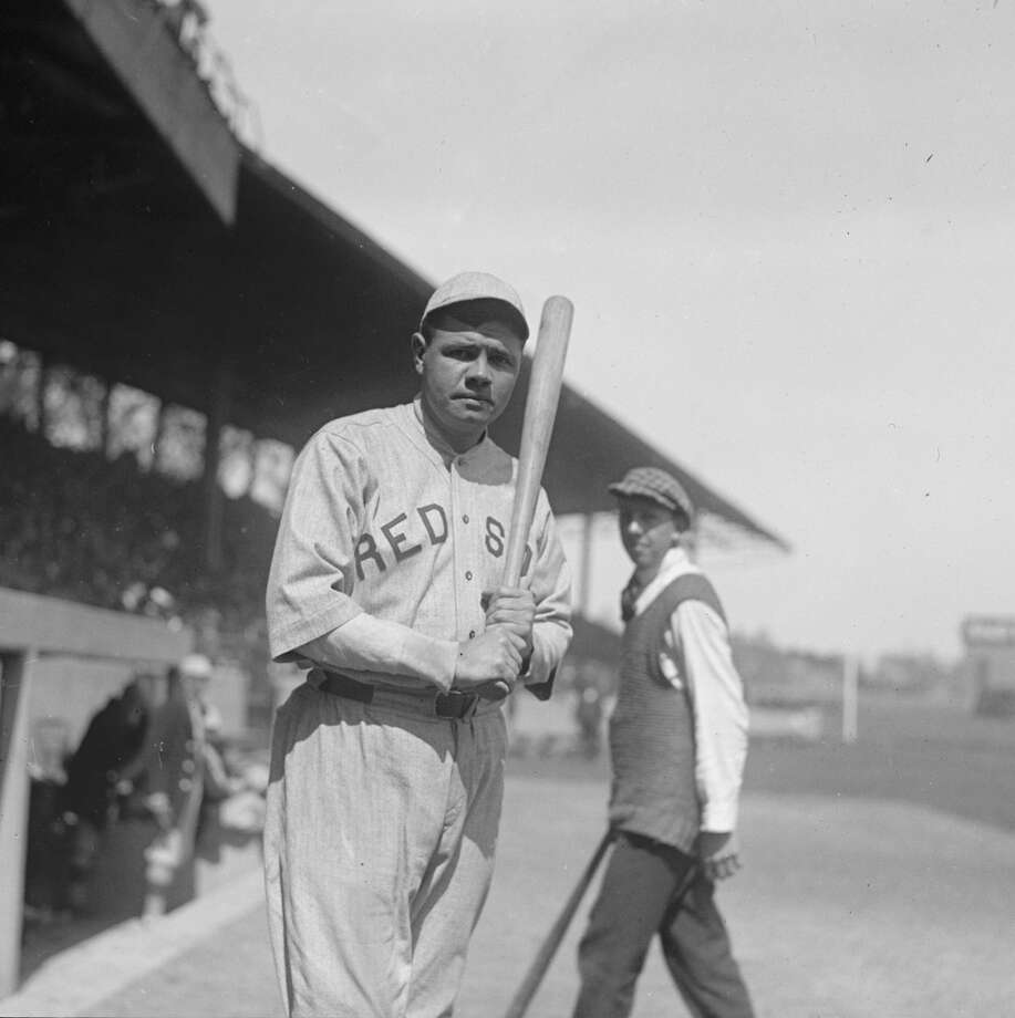 UNITED STATES - CIRCA 1919:  Babe Ruth in Red Sox Uniform with Bat at Stadium  (Photo by Buyenlarge/Getty Images)