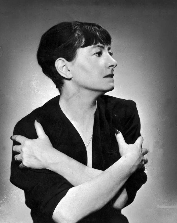 circa 1935:  American author Dorothy Parker (1893 - 1967) poses with her arms crossed.  (Photo by Hulton Archive/Getty Images)