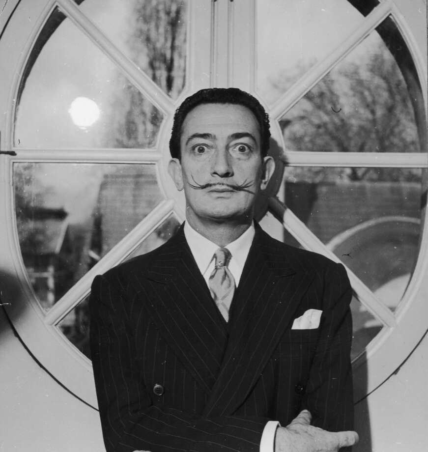 Portrait of Spanish surrealist artist Salvador Dali (1904  - 1989). He is wearing a pinstriped suit and his trademark mustache.   (Photo by Hulton Archive/Getty Images)