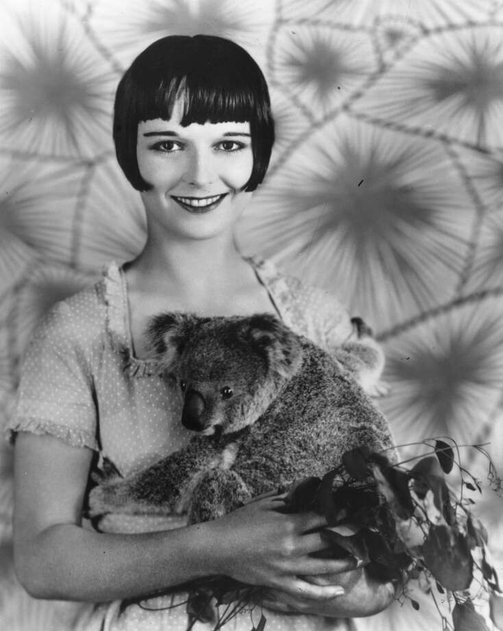 circa 1928:  Louise Brooks (1900 - 1985), a Paramount player, relaxes with a baby koala bear.  (Photo by General Photographic Agency/Getty Images)