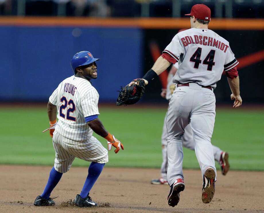 New York Mets' Eric Young Jr. reacts after being picked off as Arizona Diamondbacks first baseman Paul Goldschmidt gives chase during the first inning of the baseball game at Citi Field, Monday, July 1, 2013, in New York. (AP Photo/Seth Wenig) ORG XMIT: NYM108 Photo: Seth Wenig / AP