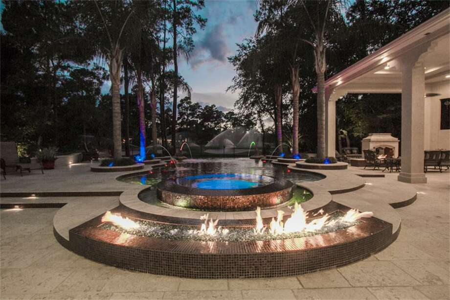 You may forget you are livingin the suburbs in this stunning four-bedroom home. Its pavilion, large pool and gorgeous view is more like a resort.