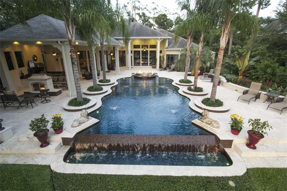 You may forget you are living in the suburbs in this stunning four-bedroom home. Its pavilion, large pool and gorgeous view is more like a resort.