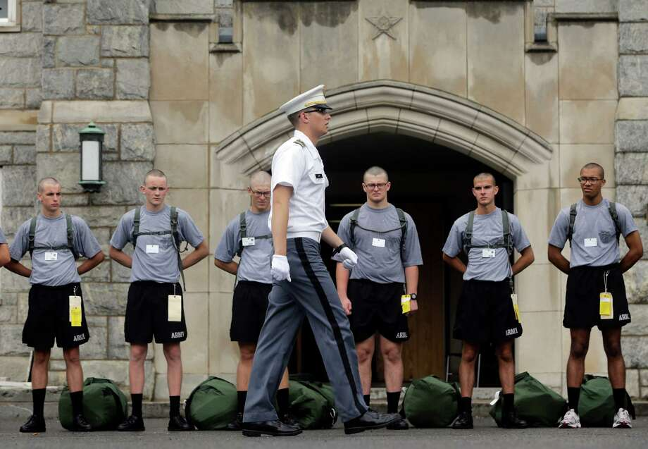 A member of the cadet cadre instructs new cadets during a marching drill on Reception Day at the U.S. Military Academy at West Point on Monday, July 1, 2013, in West Point, N.Y. The academy welcomed about 1,200 members of the Class of 2017 for cadet basic training. (AP Photo/Mike Groll) ORG XMIT: NYMG106 Photo: Mike Groll, AP / AP