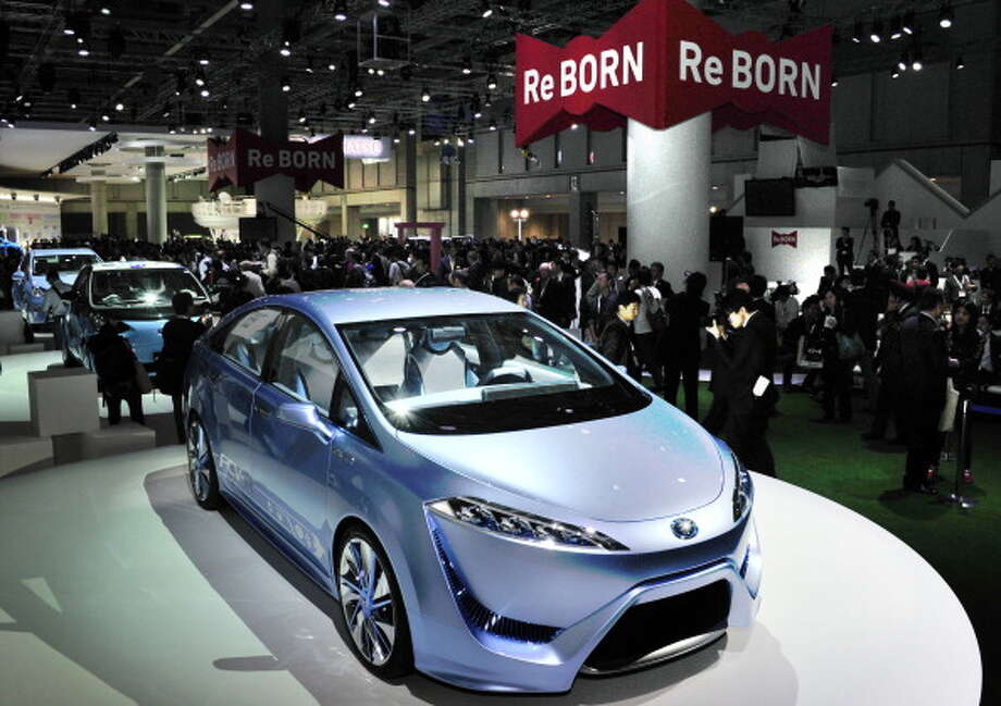 "Japan's auto giant Toyota Motor displays the concept fuel cell vehicle ""FCV-R"" at a press preview of the Tokyo Motor Show on November 30, 2011. The zero-emission four-seater sedan is expecting to be commercialized by 2015.    AFP PHOTO / Yoshikazu TSUNO Photo: YOSHIKAZU TSUNO, AFP/Getty Images / 2011 AFP"
