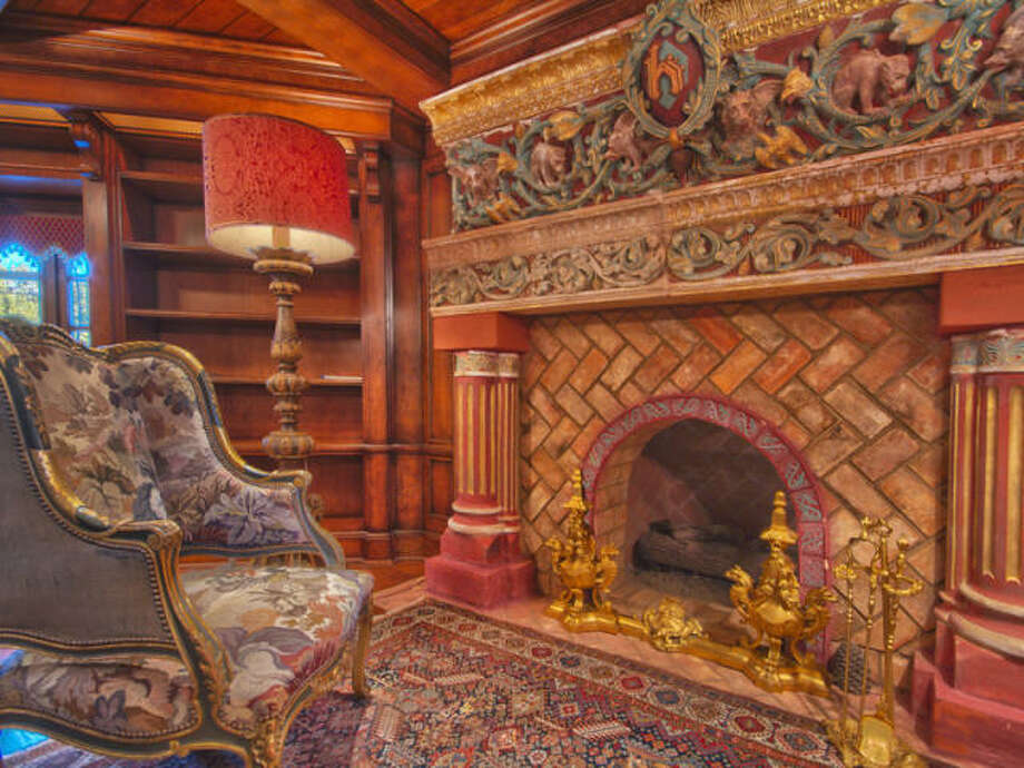 Fireplace study/living room. We're losing track. Photos via Trulia/MLS/Sotheby's