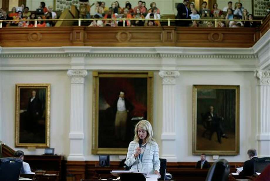 FILE -  In this June 25, 2013 file photo, Sen. Wendy Davis, D-Fort Worth, speaks during her filibuster of an abortion bill, Tuesday, June 25, 2013, in Austin, Texas. The bill will get another chance next week now that the Gov. Rick Perry has called another special legislative session.  (AP Photo/Eric Gay) Photo: Eric Gay, AP / AP