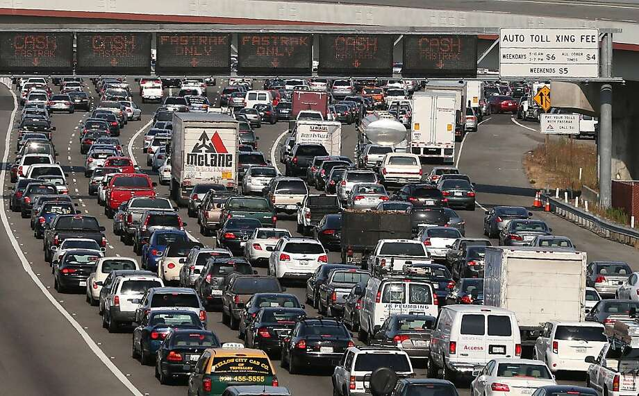 OAKLAND, CA - JULY 02:  Commuter traffic backs up at the toll plaza to the San Francisco-Oakland Bay Bridge on July 2, 2013 in Oakland, California. For a second day, hundreds of thousands of San Francisco Bay Area commuters are scrambling to find ways to work after two of San Francisco Bay Area Rapid Transit's (BART) largest unions went on strike early yesterday morning following contract negotiations with management falling apart the day before. Train operators, mechanics, station agents and maintenance workers are seeking a five percent wage increase and are fighting management who want to have workers to begin contributing to their pensions, pay more for health insurance and reduce overtime expenses.  (Photo by Justin Sullivan/Getty Images) Photo: Justin Sullivan, Getty Images