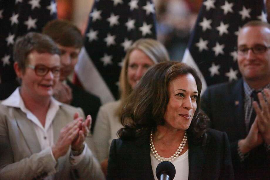 Attorney General Kamala Harris, who refused to defend Prop. 8 in court, presided over the Friday wedding of its plaintiffs: Kris Perry (left) and Sandy Stier (behind Harris). Photo: Lea Suzuki, The Chronicle