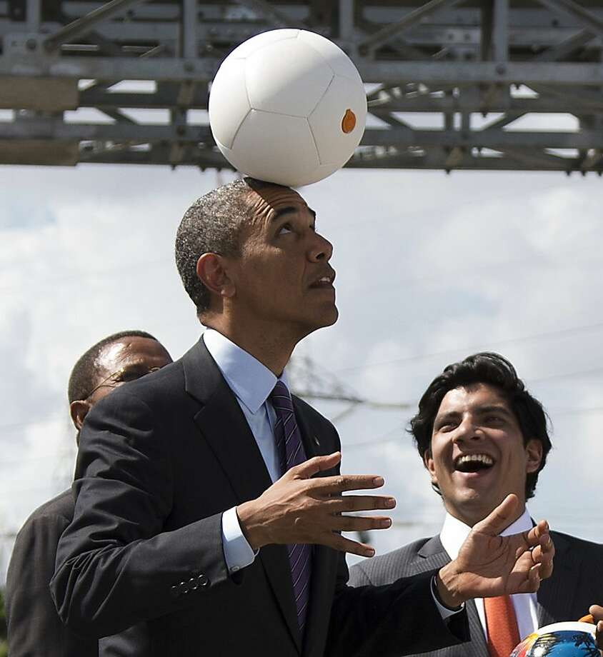Header of state: President Obama balances the Soccket Ball, which uses kinetic energy to provide power to charge a cell phone or power a light, on his forehead during a visit to the Ubungo power plant in Dar Es Salaam, Tanzania. Photo: Evan Vucci, Associated Press