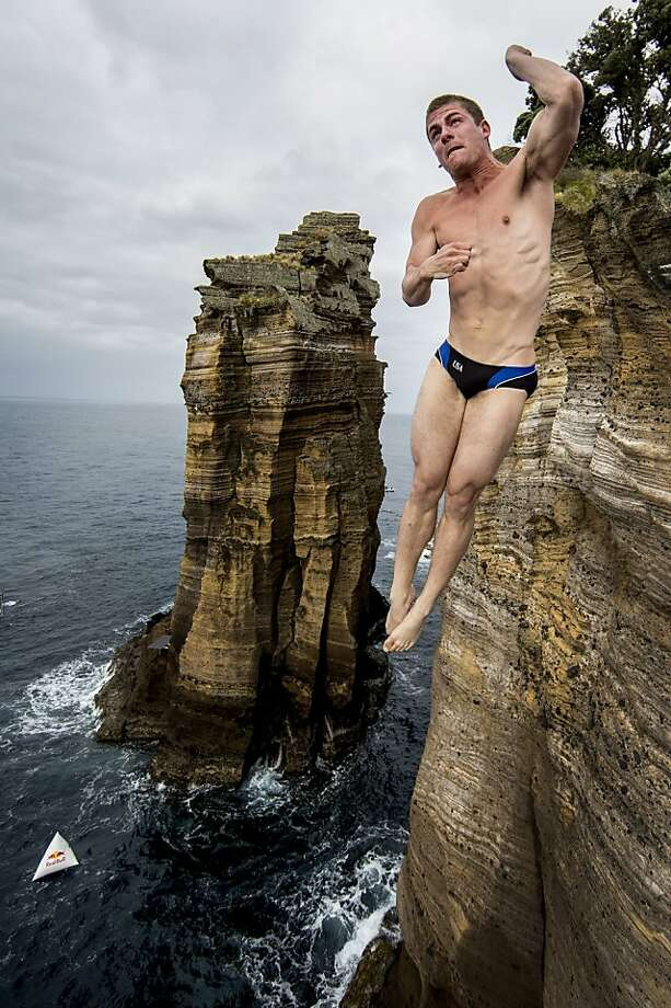 David Colturi of the USA dives from the 27 metre platform during the second competition day of the third stop of the Red Bull Cliff Diving World Series on June 29, 2013 at Islet Vila Franca do Campo, Azores, Portugal. (Photo by Dean Treml/Red Bull via Getty Images)  Photo: Handout