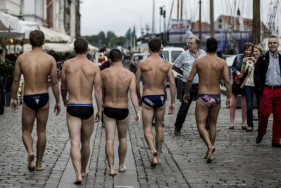 Anatoliy Shabotenko of the Ukraine, David Colturi and Steven LoBue of the USA, Mat Cowen of the UK and Orlando Duque of Colombia walk on Nyhavn Street on their way to the Copenhagen Opera House prior to the second stop of the Red Bull Cliff Diving World Series on June 22, 2013 at Copenhagen, Denmark. (Photo by Dean Treml/Red Bull via Getty Images) Photo: Handout, Red Bull Via Getty Images