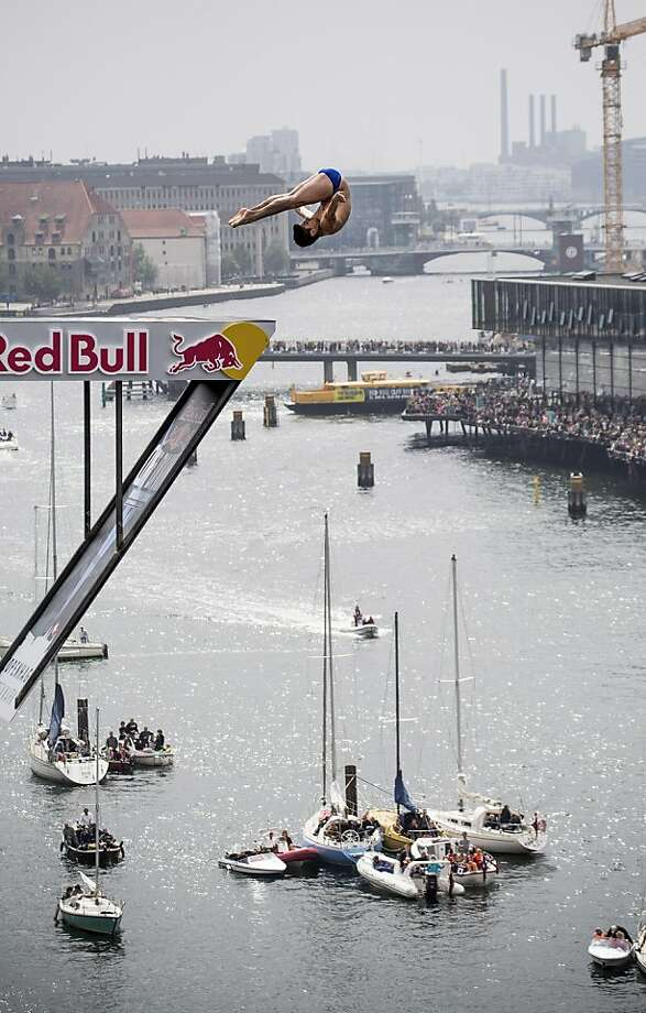 Jonathan Paredes of Mexico dives from the 28 metre platform at the Copenhagen Opera House during the second stop of the Red Bull Cliff Diving World Series on June 22, 2013 at Copenhagen, Denmark. (Photo by Romina Amato/Red Bull via Getty Images) Photo: Handout, Red Bull Via Getty Images