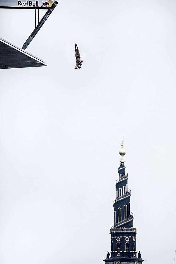 Sasha Kutsenko of the UK dives from the 28 metre platform at the Copenhagen Opera House during the second stop of the Red Bull Cliff Diving World Series on June 22, 2013 at Copenhagen, Denmark. (Photo by Balazs Gardi/Red Bull via Getty Images) Photo: Handout, Red Bull Via Getty Images