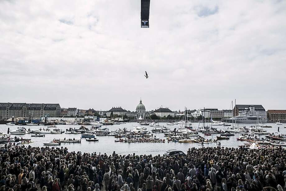 David Colturi of the USA dives from the 28 metre platform on the roof of the Copenhagen Opera House during the second stop of the Red Bull Cliff Diving World Series in Copenhagen, Denmark Saturday June 22, 2013. Artem SIlchenko of Russia won the event, followed by Gary Hunt of the UK and third Orlando Duque of Colombia. (AP Photo/Romina Amato, Red Bull) Photo: Romina Amato, Associated Press