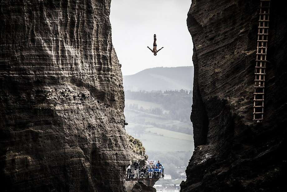 It's a long way downfor Jonathan Paredes of Mexico, who does a Peter Pan off the 27-meter platform during the Red Bull Cliff Diving World Series at Islet Vila Franca do Campo, Azores. Photo: Handout