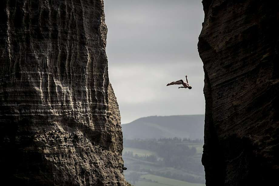 This handout photo received from Red Bull and taken on June 29, 2013 shows Andy Jones of the USA diving from the 27 metre platform during the third stop of the Red Bull Cliff Diving World Series in Ilset Vila Franca do Campo, Azores, Portugal. The event was won by Gary Hunt of the UK with Orlando Duque of Colombia second and Jonathan Paredes of Mexico third.  Photo: Dean Treml, AFP/Getty Images