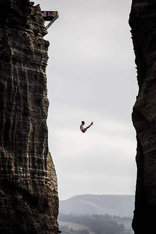 Gary Hunt of the UK dives from the 27 metre platform during the third stop of the Red Bull Cliff Diving World Series in Ilset Vila Franca do Campo, Azores, Portugal. The event was won by Hunt with Orlando Duque of Colombia second and Jonathan Paredes of Mexico third. Photo: Dean Treml, AFP/Getty Images