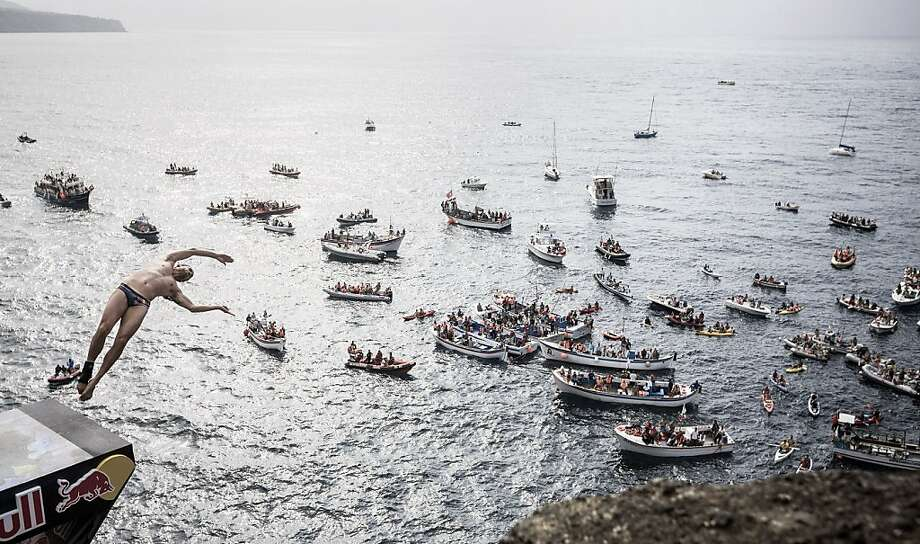This handout photo received from Red Bull and taken on June 29, 2013 shows Orlando Duque of Colombia diving from the 27 metre platform during the third stop of the Red Bull Cliff Diving World Series in Ilset Vila Franca do Campo, Azores, Portugal.  Photo: Romina Amato, AFP/Getty Images