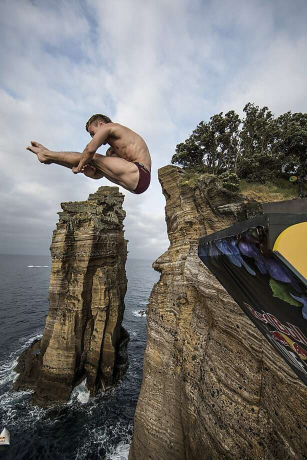 Mat Cowen of the UK dives from the 27 metre platform during the second competition day of the third stop of the Red Bull Cliff Diving World Series on June 29, 2013 at Islet Vila Franca do Campo, Azores, Portugal. (Photo by Dean Treml/Red Bull via Getty Images) Photo: Handout, Red Bull Via Getty Images