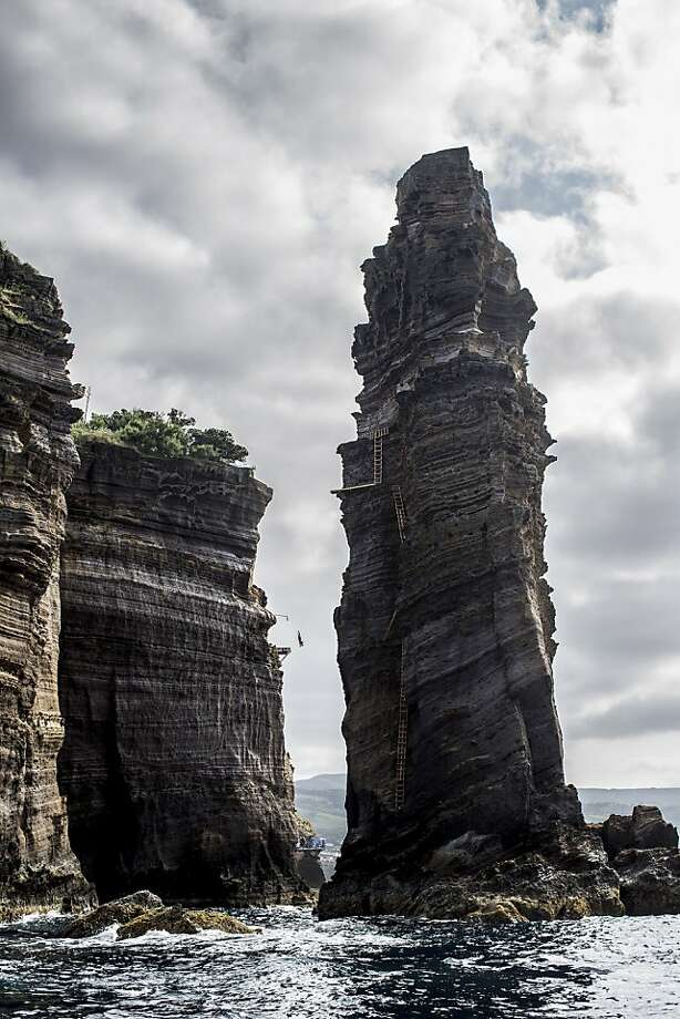 Blake Aldridge of the UK dives from the 27 metre platform during the second competition day of the third stop of the Red Bull Cliff Diving World Series on June 29, 2013 at Islet Vila Franca do Campo, Azores, Portugal. Photo: Handout, Red Bull Via Getty Images
