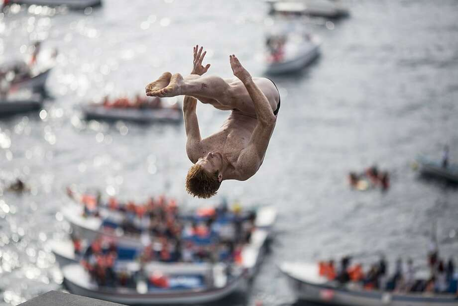 In this handout image provided by Red Bull, Andy Jones of the USA dives from the 27 metre platform during the second competition day of the third stop of the Red Bull Cliff Diving World Series on June 29, 2013 at Islet Vila Franca do Campo, Azores, Portugal. (Photo by Dean Treml/Red Bull via Getty Images) Photo: Handout, Red Bull Via Getty Images
