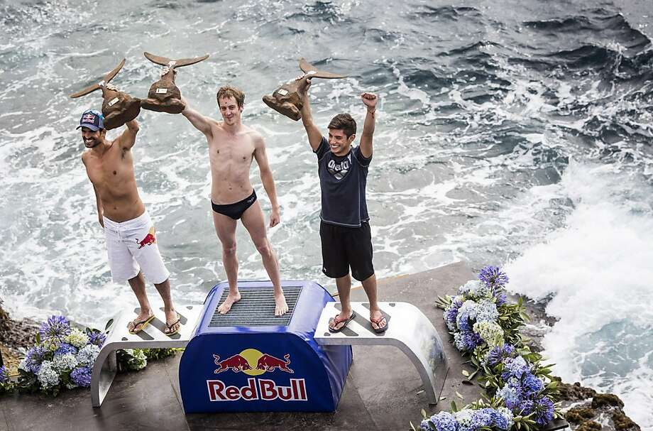 In this handout image provided by Red Bull, second place Orlando Duque (L) of Colombia, event winner Gary Hunt (C) of the UK and third place Jonathan Paredes (R) of Mexico celebrate on the podium during the second competition day of the third stop of the Red Bull Cliff Diving World Series on June 29, 2013 at Islet Vila Franca do Campo, Azores, Portugal. (Photo by Romina Amato/Red Bull via Getty Images) Photo: Handout, Red Bull Via Getty Images