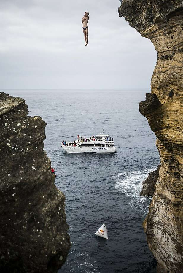In this handout image provided by Red Bull, Gary Hunt of the UK dives from the 27 metre platform during the second competition day of the third stop of the Red Bull Cliff Diving World Series on June 29, 2013 at Islet Vila Franca do Campo, Azores, Portugal. (Photo by Romina Amato/Red Bull via Getty Images) Photo: Handout, Red Bull Via Getty Images