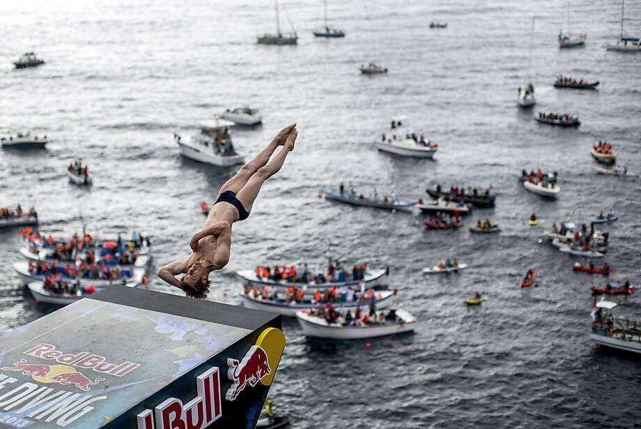 Gary Hunt of the UK dives from the 27 metre platform during the second competition day of the third stop of the Red Bull Cliff Diving World Series on June 29, 2013 at Islet Vila Franca do Campo, Azores, Portugal. (Photo by Dean Treml/Red Bull via Getty Images) Photo: Handout, Red Bull Via Getty Images