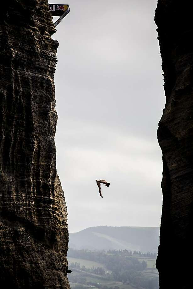 Gary Hunt of the UK dives from the 27 metre platform during the second competition day of the third stop of the Red Bull Cliff Diving World Series on Islet Vila Franca do Campo, Azores, Portugal Saturday June 29, 2013.  Hunt  won the event, followed by Orlando Duque of Colombia and third was Jonathan Paredes of Mexico. (AP Photo/HO/Dean Treml) Photo: Dean Treml, Associated Press
