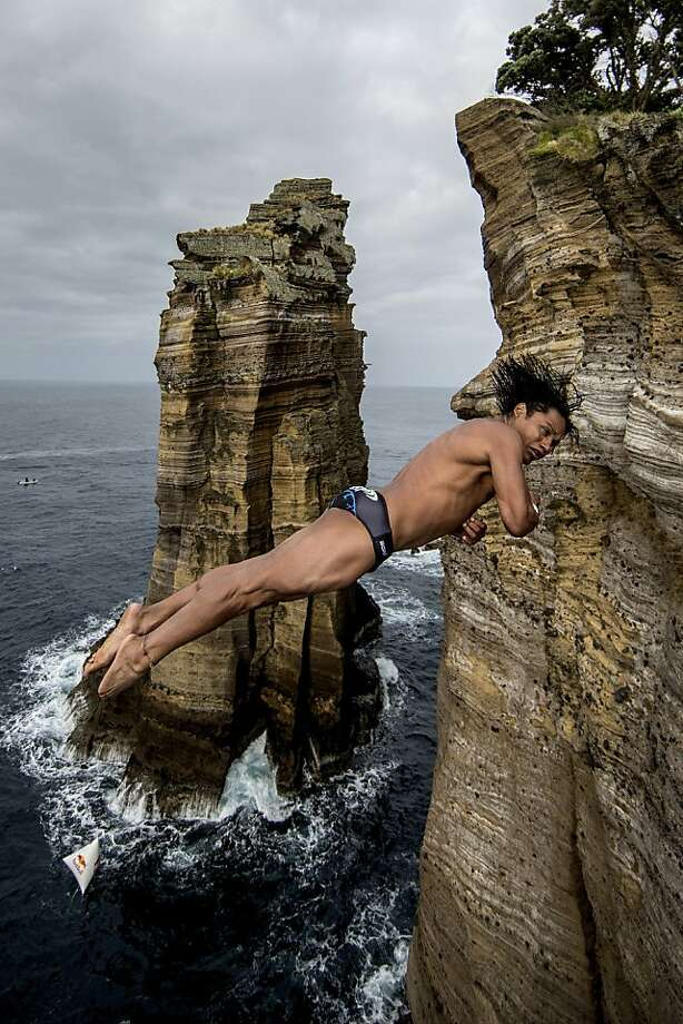 Eber Pava of Colombia dives from the 27 metre platform during the second competition day of the third stop of the Red Bull Cliff Diving World Series on Islet Vila Franca do Campo, Azores, Portugal Saturday June 29, 2013. Gary Hunt of the UK won the event, followed by Orlando Duque of Colombia and third was Jonathan Paredes of Mexico. (AP Photo/HO/Dean Treml) Photo: Dean Treml, Associated Press