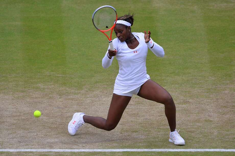 TOPSHOTS US player Sloane Stephens returns against France's Marion Bartoli during their women's singles quarter-final match on day eight of the 2013 Wimbledon Championships tennis tournament at the All England Club in Wimbledon, southwest London, on July 2, 2013. AFP PHOTO / CARL COURT  -  RESTRICTED TO EDITORIAL USECARL COURT/AFP/Getty Images ORG XMIT: 2831 Photo: CARL COURT, Getty / AFP