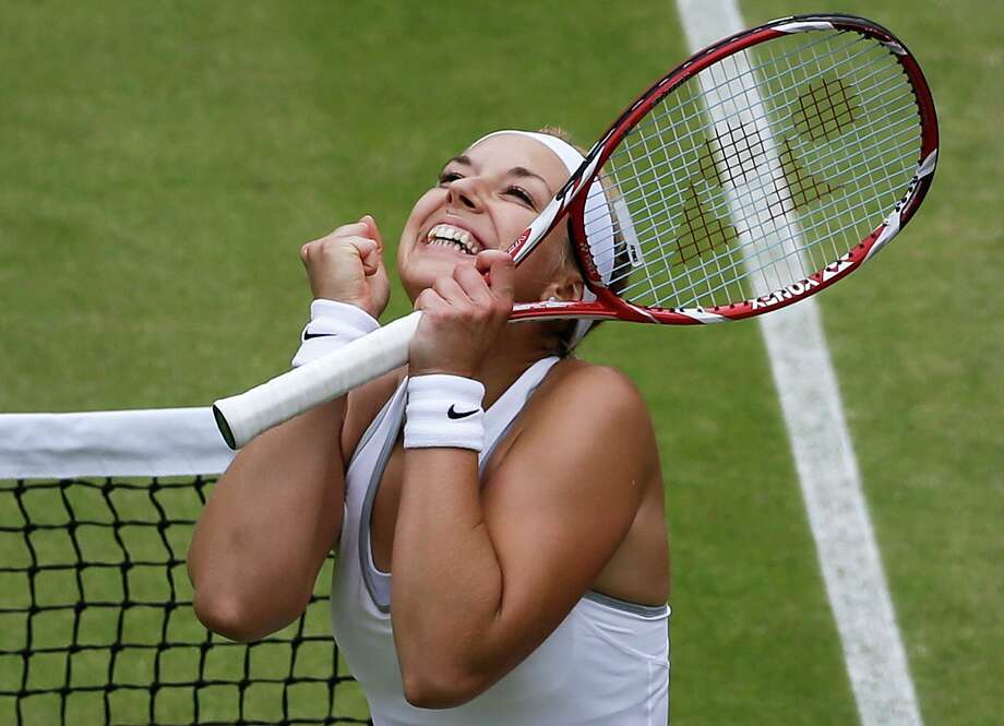 Sabine Lisicki of Germany reacts as she wins a Women's singles quarterfinal match against Kaia Kanepi of Estonia at the All England Lawn Tennis Championships in Wimbledon, London, Tuesday, July 2, 2013. (AP Photo/Anja Niedringhaus)  ORG XMIT: WIM335 Photo: Anja Niedringhaus, AP / AP