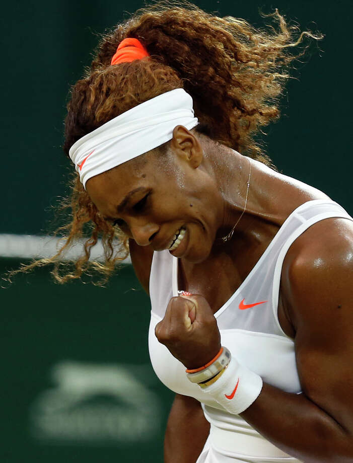 Serena Williams of the United States reacts after winning a point as she plays Kimiko Date-Krumm of Japan during their Women's singles match at the All England Lawn Tennis Championships in Wimbledon, London,  Saturday, June 29, 2013. (AP Photo/Sang Tan) ORG XMIT: WIM451 Photo: Sang Tan, AP / AP