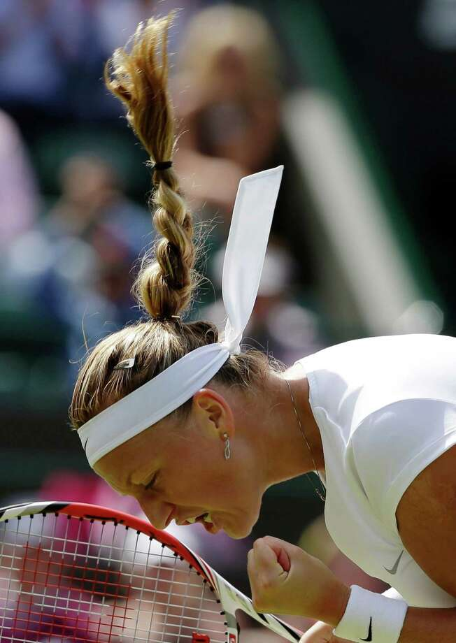 Petra Kvitova of the Czech Republic celebrates after beating Ekaterina Makarova of Russia in their Women's singles match at the All England Lawn Tennis Championships in Wimbledon, London, Saturday, June 29, 2013. (AP Photo/Anja Niedringhaus) ORG XMIT: WIM139 Photo: Anja Niedringhaus, AP / AP