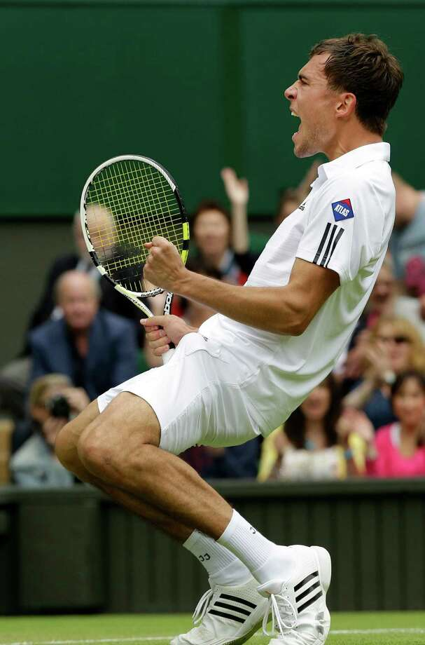 Jerzy Janowicz of Poland reacts after defeating Nicolas Almagro of Spain in their Men's singles match at the All England Lawn Tennis Championships in Wimbledon, London, Friday, June 28, 2013. (AP Photo/Anja Niedringhaus) ORG XMIT: WIM236 Photo: Anja Niedringhaus, AP / AP