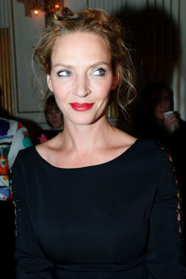 PARIS, FRANCE - JUNE 30:  Actress Uma Thurman attends the Versace show as part of Paris Fashion Week Haute-Couture Fall/Winter 2013-2014 at  on June 30, 2013 in Paris, France.  (Photo by Bertrand Rindoff Petroff/Getty Images)