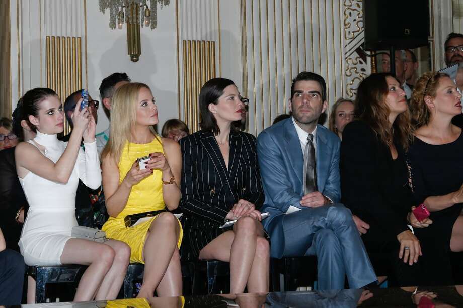 PARIS, FRANCE - JUNE 30:  (L-R) Actors Emma Roberts, Mena Suvari, Delphine Chaneac and Zachary Quinto attend the Versace show as part of Paris Fashion Week Haute-Couture Fall/Winter 2013-2014 at  on June 30, 2013 in Paris, France.  (Photo by Bertrand Rindoff Petroff/Getty Images)