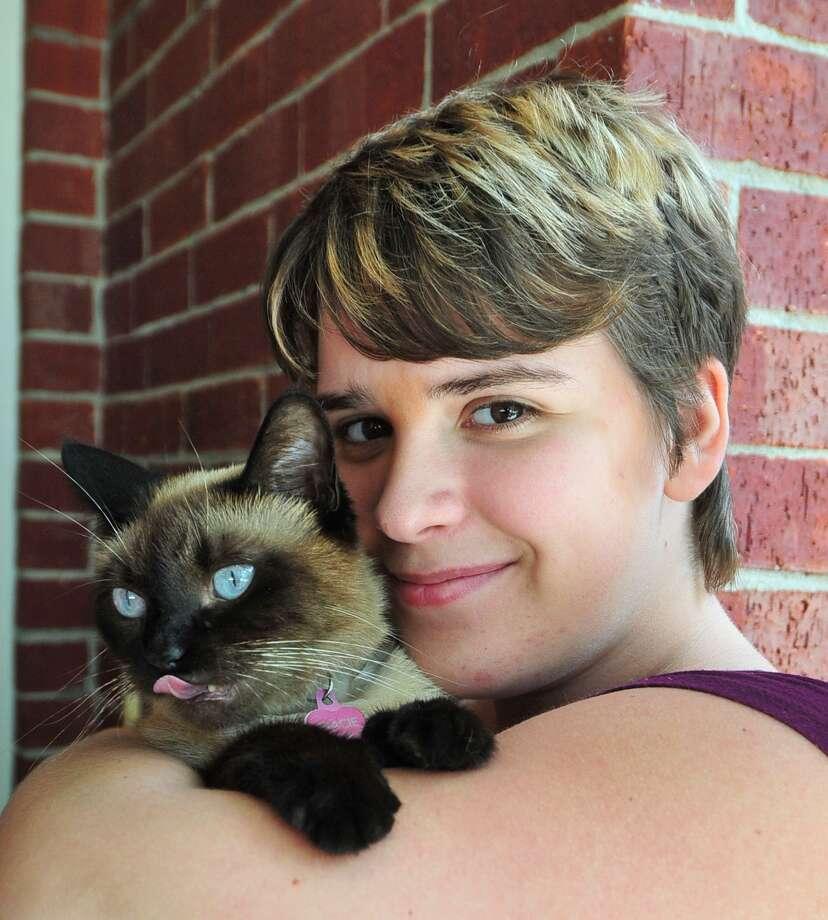 "Gabby Neely-Smith, 18, keeps company with her cat ""Gracie"" at home as she waits for a bone marrow transplant.     Gabby Neely-Smith, 18, keeps company with her cat ""Gracie"" at home as she waits for a bone marrow transplant. Photo: Â Tony Bullard 2013, Freelance Photographer / © Tony Bullard & the Houston Chronicle"
