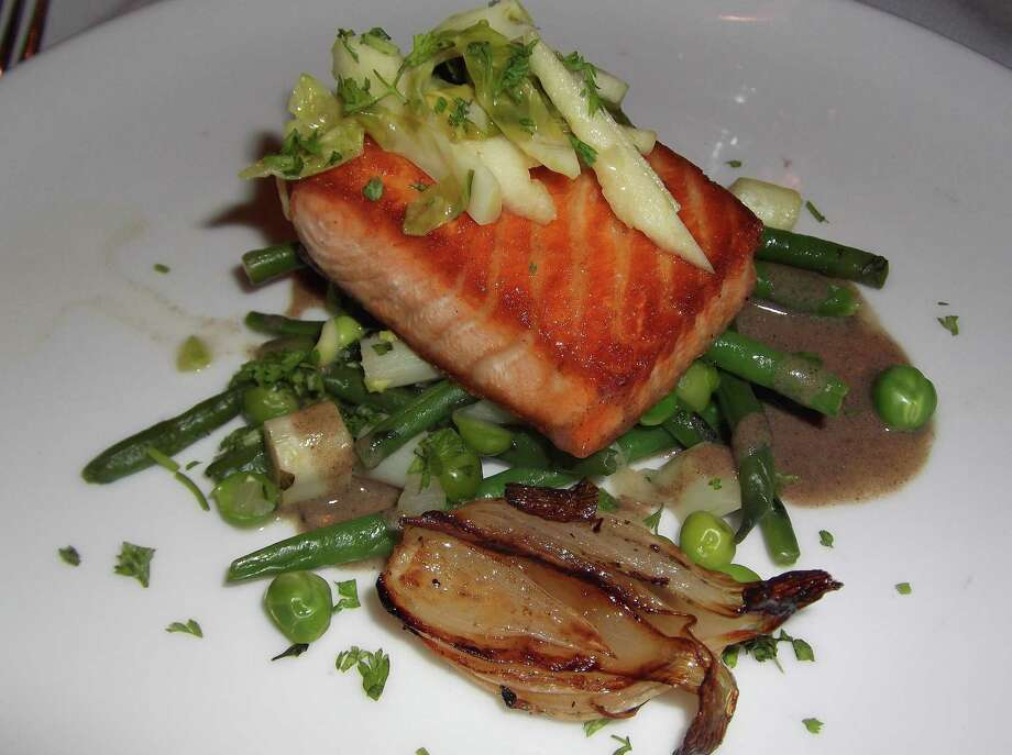 Entrees at 323 include pasta, chicken, lamb, beef and fish, such as this salmon with spring ragout. Photo: Patti Woods / Westport News