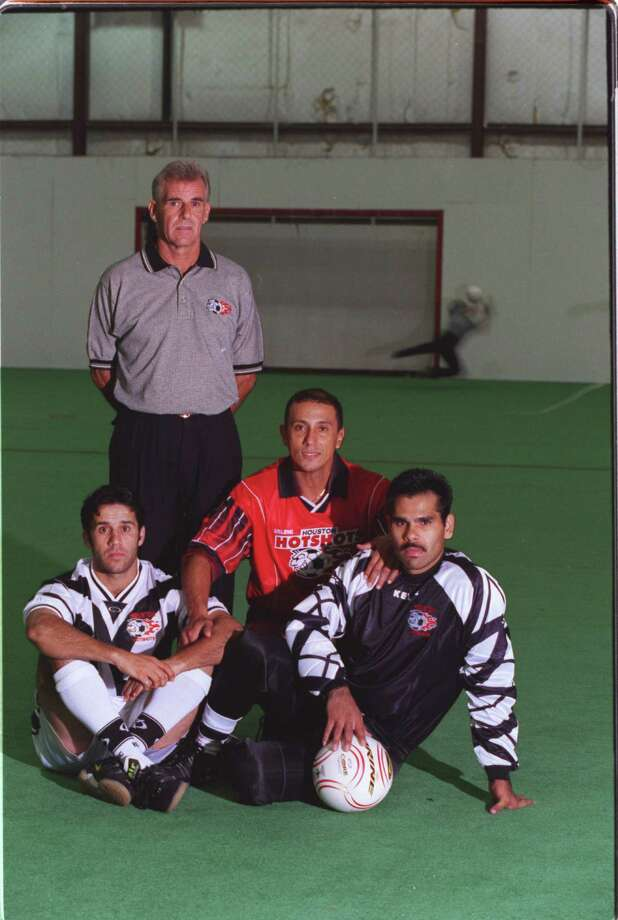 (bottom l. to r) original Hotshots Ziad Allan along with  Mirko Castillo and goalie Juan De La O (cq) (who is not an original team member).  Coach Trevor Dawkins is standing.  Photo on 7-13-99 at Hotshots practice facility while preparing to open the new season.  HOUCHRON CAPTION (07/18/1999):   Return engagement: Joining coach Trevor Dawkins, standing, are, from left, Ziad Allan, Mirko Castillo and Juan De La O. Photo: John Everett, Staff / Houston Chronicle
