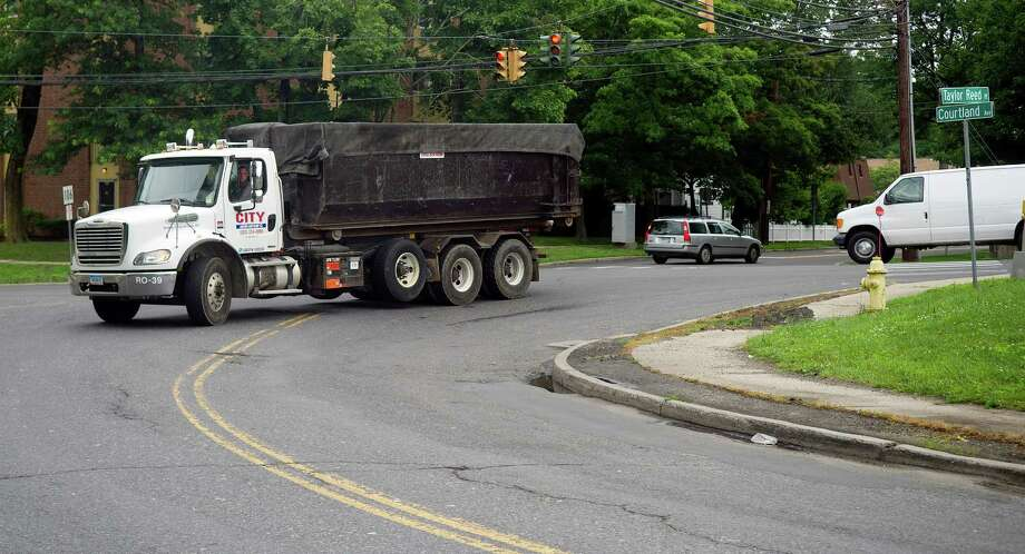 City Carting trucks travel through the intersection of Taylor Reed Place and Courtland Ave. in Stamford, Conn., on Tuesday, July 2, 2013. Photo: Lindsay Perry / Stamford Advocate